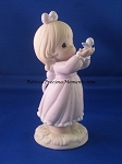 Sharing A Gift Of Love - Precious Moment Figurine