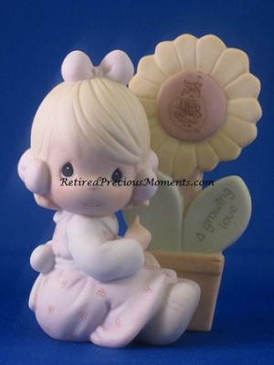 A Growing Love - Precious Moment Figurine