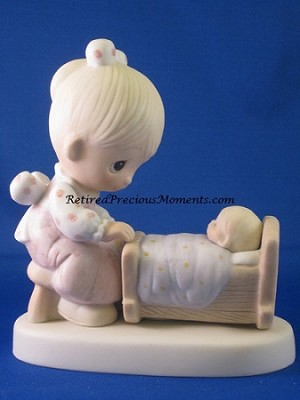 The Hand That Rocks The Future - Precious Moment Figurine