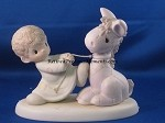 We're Pulling For You - Precious Moment Figurine